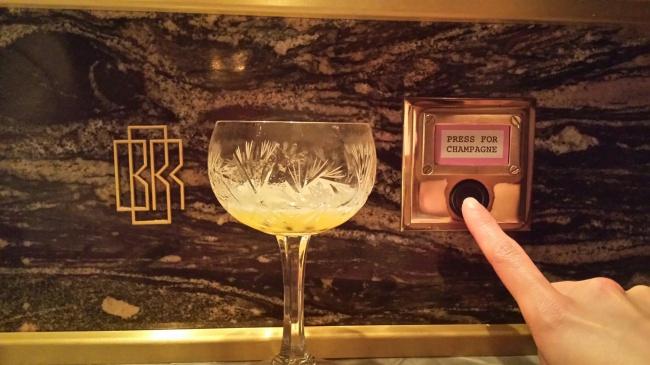 cocktailpressforchampagnebuttonBBRNHYM